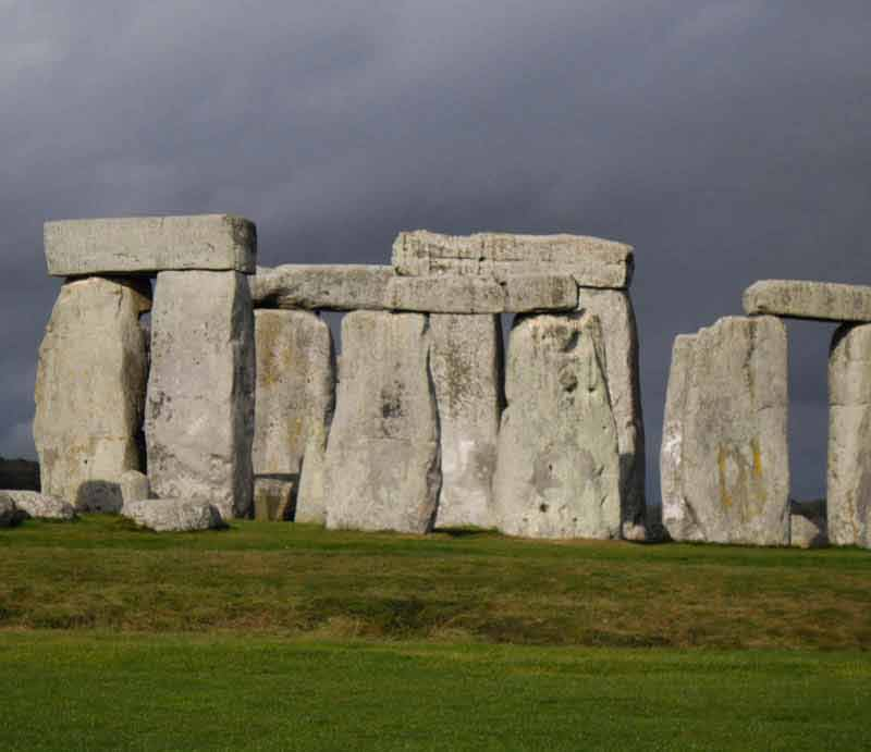 The standing stones at Stonehenge beneath a grey sky.